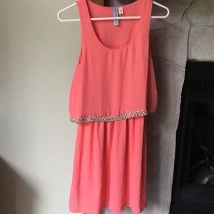 Pink knee length dress with jewel accents